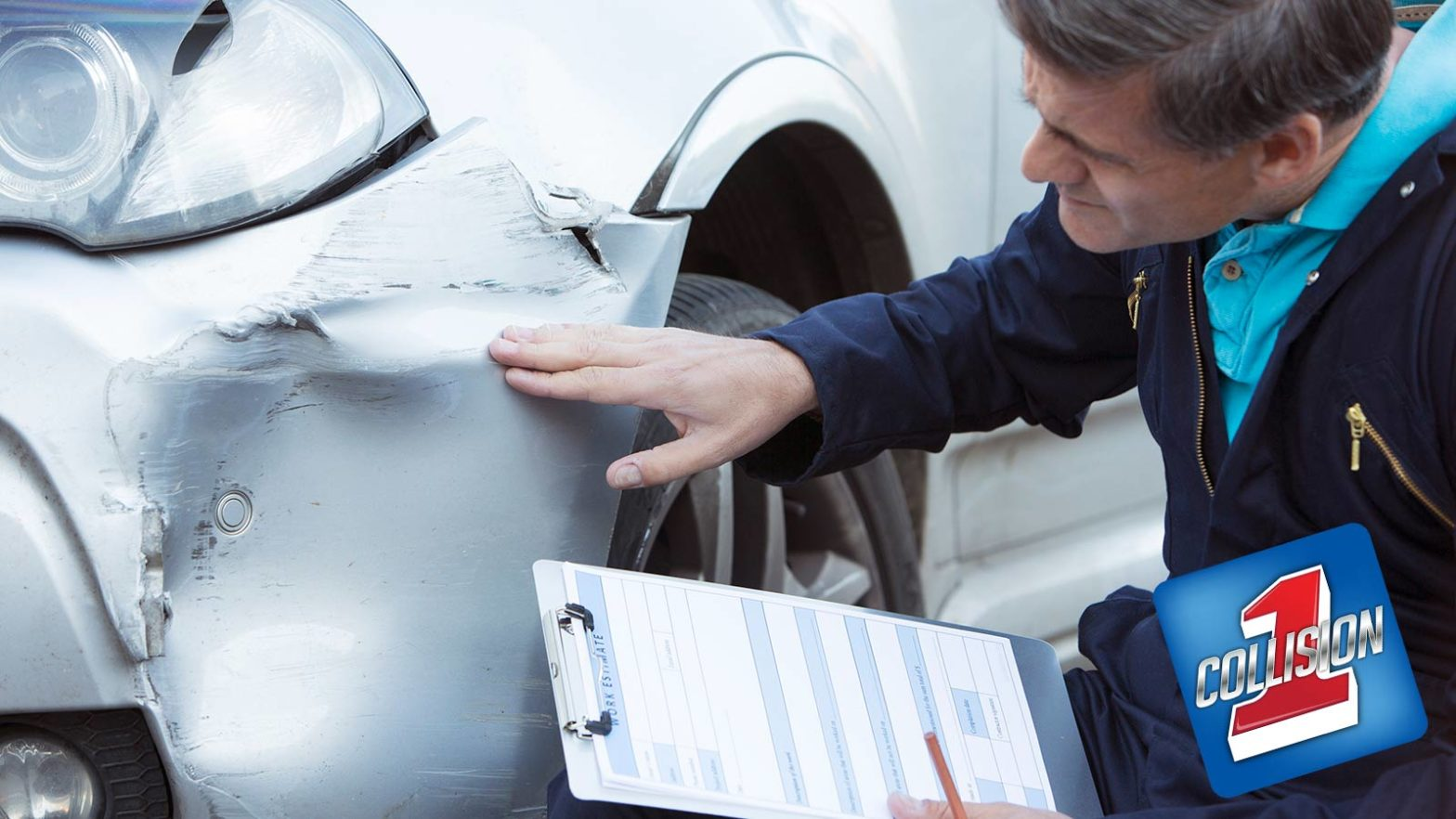 Man inspecting auto body damage holding a clip board while preparing an estimate after a collision.